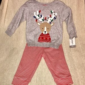 Reindeer sweater and red striped pants.